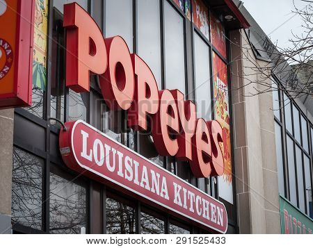 Toronto, Canada - November 13, 2018: Popeyes Louisiana Restaurant Logo In Front Of Their Local Resta