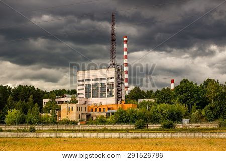 A View Of The Industrial Development On The Background Of Gloomy Clouds. Buildings Of The Obninsk Nu