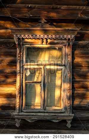 Window Of An Old Wooden Village House With Platbands