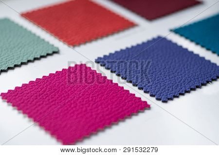 Catalog of multicolored imitation leather from matting fabric texture background, leatherette fabric texture. Industry background. poster