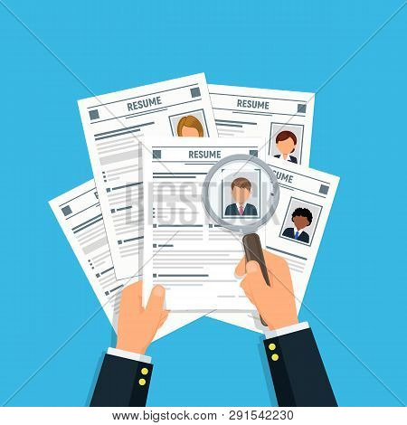Hands Businessman With Resume Cv And Magnifying Glass. Analyzing Personnel Resume. Hiring Concept. R