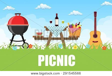 Outdoor Picnic In Park Table Covered With Tartan Cloth. Picnic Basket Filled With Food On The Chair.