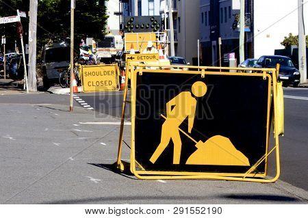 Warning Sign Advising Night Road Work Ahead.
