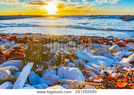 Rocky Foreshore At Sunset Rocks, Seaweed Catching The Light With Colorful Sky Beyond The Sea,