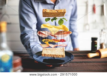 Deconstructed Sandwich Layers In Kitchen And Businessman