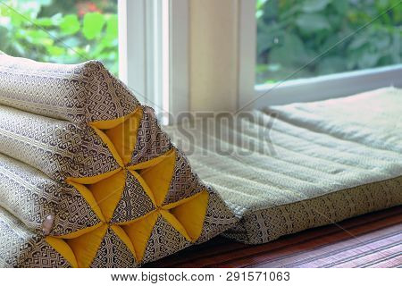 Triangle Backrest Pillow And Folding Mattress Prepared Closed To Window Exit Of Living Room To The O