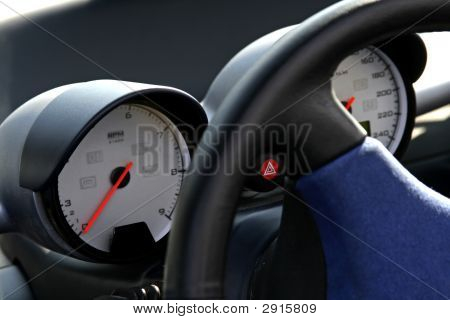 Rpm And Speedo Dials On Car Dashboard