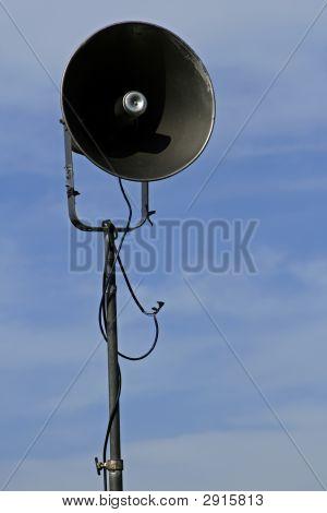 Race Loud Speaker Against Blue Cloudy Sky