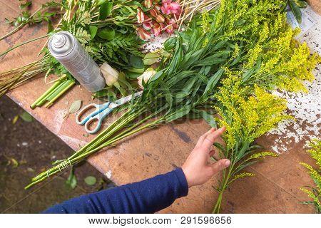 Florist Worktable. Florist At Work Creating Bouquet At Flower Shop. Top View .