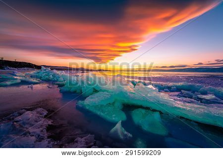 Landscape View Of Baikal Lake In Winter Season With Colorful Sunset Sky Background, Shamanka Cape, B