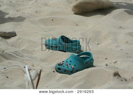 Childrens Crocks On A Beach