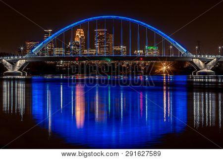 Minneapolis, Usa -november 13, 2015: Lowry Bridge Colored Blue With Minneapolis Skyline Behind