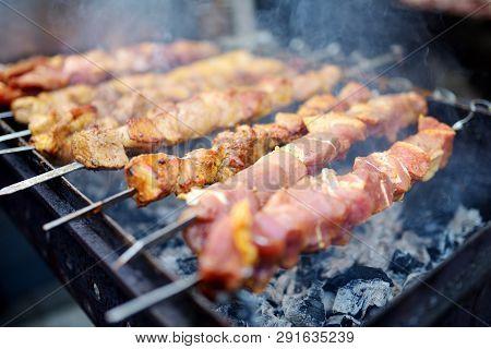 Chicken Kabobs Grilled On Metal Skewers Outdoors