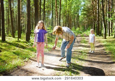 Middle Age Woman Applying Insect Repellent To Her Granddaughter Before Forest Hike Beautiful Summer