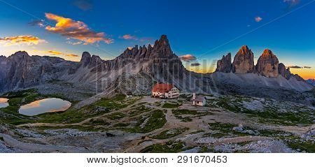 Panoramic View Of  Tre Cime And  Rifugio Hut Before Sunrise In Summer, Tre Cime Di Lavaredo National