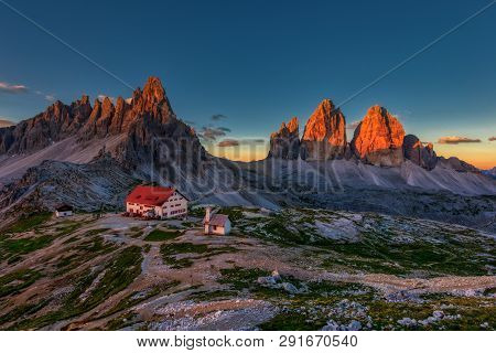 Tre Cime And  Rifugio Hut At Sunrise In Summer In  Dolomites, Italy.