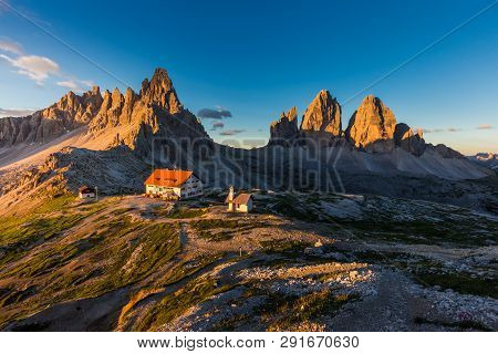 Tre Cime And Rifugio Hut At Sunrise In Summer In  Dolomites, Italy