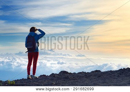 Tourist Admiring Breathtaking Sunset Views From The Mauna Kea, A Dormant Volcano On The Island Of Ha
