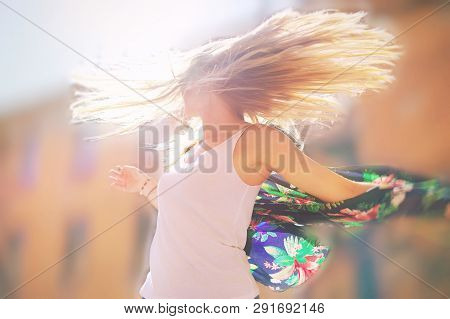Attractive Happy Young Woman In White T Shirt Flying Hair Enjoying Her Free Time At Sunset Outdoor.