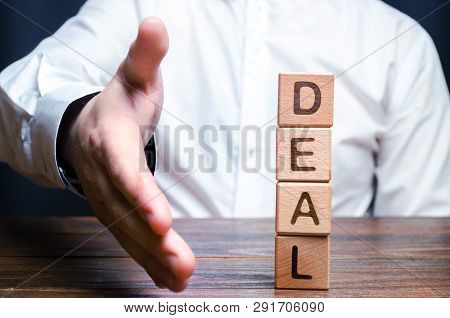 The Businessman Holds Out His Hand To Make A Deal. Concept Of A Contract Or Deal, Making An Offer. S