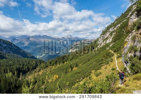 Man Traveler Hiking In Landscape Of Dolomites Mountains In Italy. Travel Adventure Concept, Dolomite