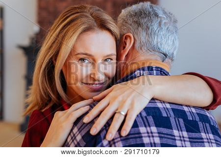 Beautiful Green-eyed Woman Hugging Her Supportive Man