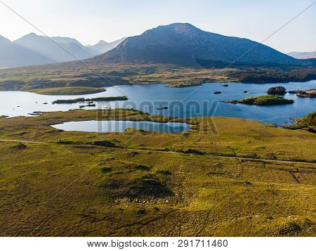 Beautiful Sunset View Of Connemara. Scenic Irish Countryside Landscape With Magnificent Mountains On