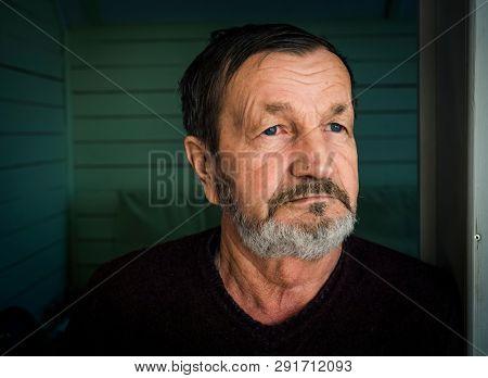 Pensive elderly mustache man face