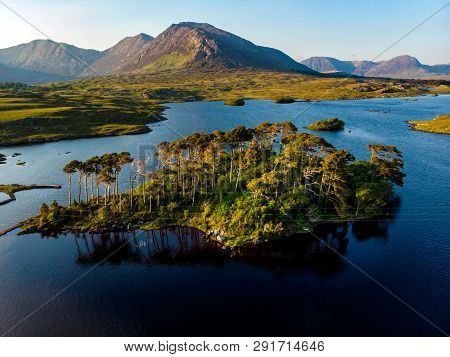 Twelve Pines Island, Standing On A Gorgeous Background Formed By The Sharp Peaks Of A Mountain Range