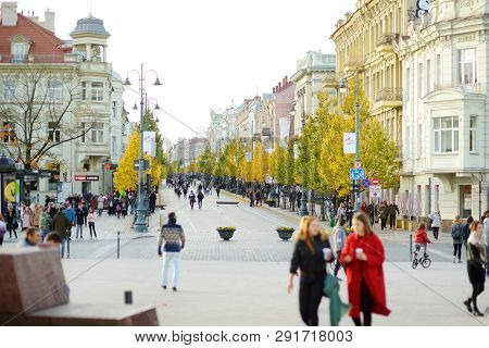 Vilnius, Lithuania - October 12, 2017: Lots Of People Walking Down The Streets Of Vilnius Old Town.