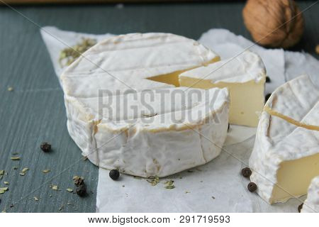 Camembert Cheese. Farm Products, Rustic Cheese. Natural Cheese, Round Head Of Cheese With Camembert