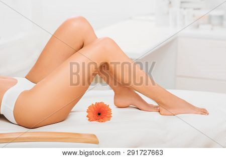 Smooth And Slim Female Legs. Cropped Womans Perfect Legs At Spa