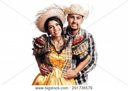 Brazilian Couple Wearing Traditional Clothes For Festa Junina - June Festival - Dancing Isolated On