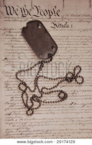 Freedom is not free . Dog tag on American Constitution.