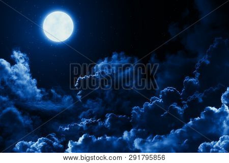 Mystical Bright Full Moon In The Midnight Sky With Stars Surrounded By Dramatic Clouds. Dark Natural