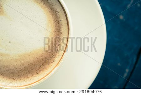 Vintage Flatlay Half Heart Shape Froth Milk Latte Art in White Coffee Cup on Black Wood Table. Heart shape froth milk Latte art hot beverage for coffee lover poster