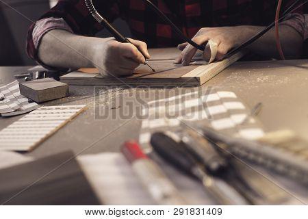 An Artist Using Wood. Handmade Use Of A Drill