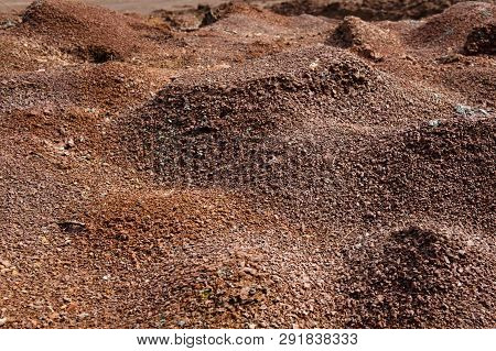 Red Earth Or Soil Background. Tropical Laterite Soil  Background Of Red Clay. Dry Orange Surface, Pi