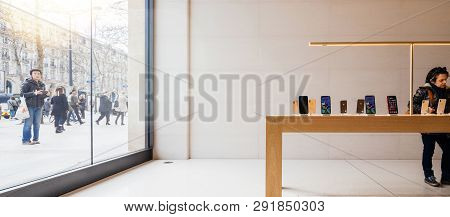 Paris, France - Mar 19 2019: Wide Image Of Woman Shopping For New Iphone Xs Inside The Minimalist An