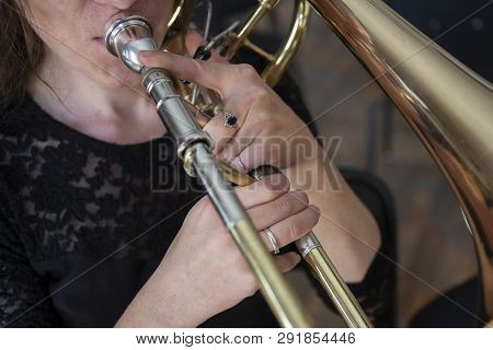 Hands Of A Girl Playing The Trombone