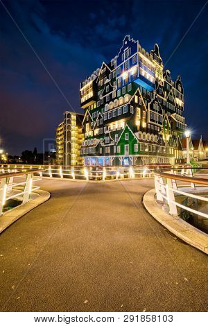 ZAANDAM, NETHERLANDS - MAY 21, 2018: Inntel Hotel in Zaandam illuminated at night. Design of 12-storey tall building opened in 2009 is the result of stacking a series of traditional Dutch houses