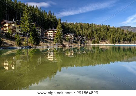 Ruzomberok, Slovakia - March 21: Reflection Of Apartments In Water At Summer Resort Hrabovo On March