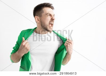 Young Casual Man Shouting. Shout. Crying Emotional Man Screaming On Studio Background. Male Half-len