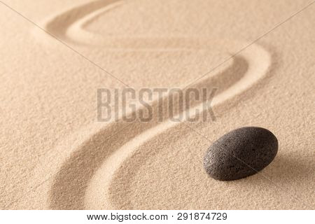 meditation stone in Japanese zen garden. Concept for focus and  concentration to reach spiritual balance, purity and harmony of mind and soul. Spa wellness or mindfulness background with copy space.