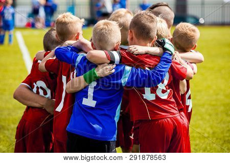 Team Sports For Kids. Children Sports Soccer Team. Coach Motivate Soccer Players To Play As A Team.