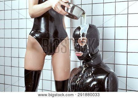 Woman Pours Milk On A Man.