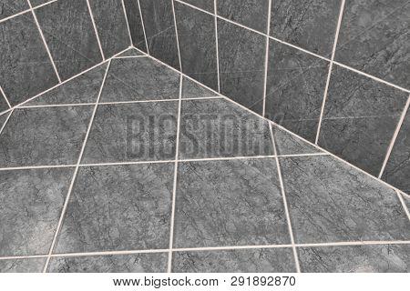 Tiled bathroom floor reflecting light