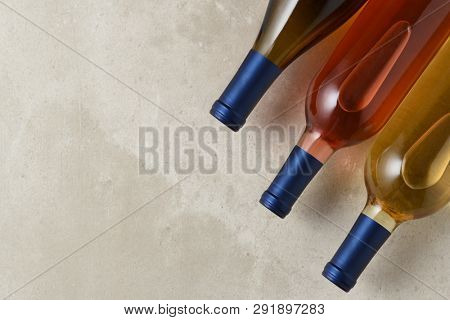 Three Wine Bottles: A group of three differetn wine bottles from a high angle. Charodnnay, Blush and Sauvignon Blanc wines with copy space.