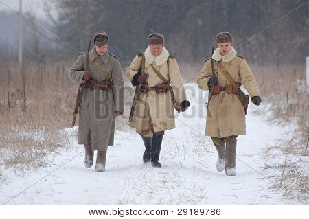KIEV, UKRAINE - FEB 20: Members of military history club RedStar wear historical Soviet uniform during historical reenactment of WWII,February 20, 2011 in Kiev, Ukraine
