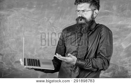 Teacher Bearded Man Confused Work With Modern Laptop Chalkboard Background. Hipster Teacher Confused